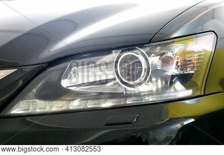 Headlight Of A Black Car. Xenon With Lens, Modern, Close-up