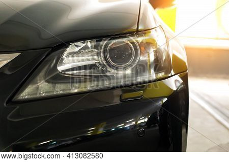 A Modern Headlight With A Black Car Lens. Good Road Lighting, Sunset