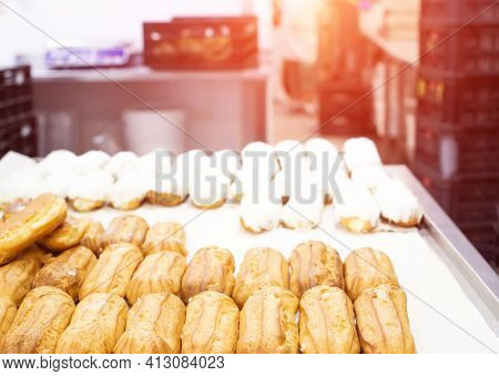 Confectionery For The Production Of Desserts And Sweets, Making Custard Cake Eclairs With Cream And