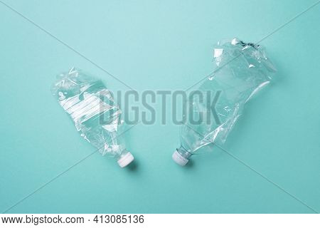 Plastic Bottles On Blue Background. Top View. Recycle Plastic, Waste Pollution Concept. Top View, Co