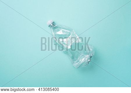 Plastic Empty Rumpled Bottles On A Blue Background. Top View, Copy Space. Zero Waste. Pollution, Env