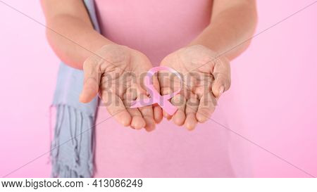 Muslim Woman Wearing A Hijab With A Ribbon On Her Chest Shows Prevention Of Breast Cancer. On A Pink