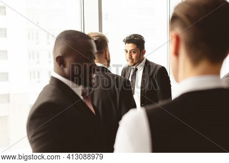 Dialogue Of Two Men With With Smartphones Young Businessmen In Suits Working And Communicating Toget