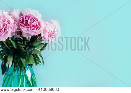 Wedding, Birthday, Anniversary Bouquet. Pink Peony Flower On Blue Background. Copy Space. Trendy Pas