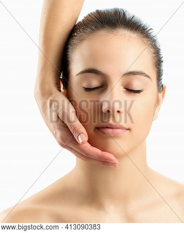 Macro Close Up Cosmetic Portrait Of Young Woman With Eyes Closed. Female Hand Touching Woman's Cheek