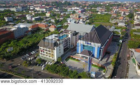 Kuta, Bali, Indonesia, March 15, 2021. Aerial Drone View Of Kuta City. Flying Over Bali Villas In Ku