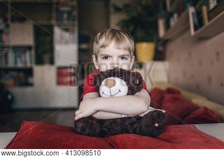 Little Boy In Tears Hugging His Teddy Bear With Sad Feelings, Negative Emotions Concept