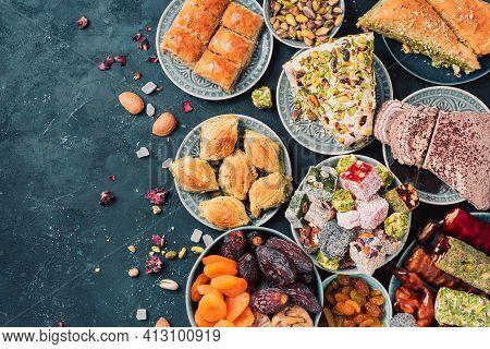 Middle Eastern Sweets On Dark Background. Arab Dessert, Baklava, Halva, Rahat Lokum, Sherbet, Nuts,