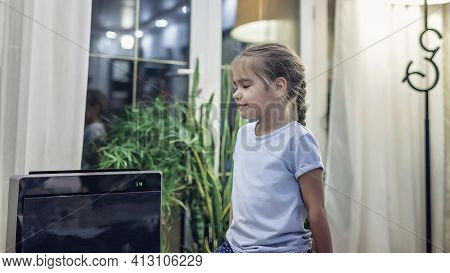Cute Little Girl Sitting Near Portable Air Purifier In The Living Room At Home, New Technology To Pr