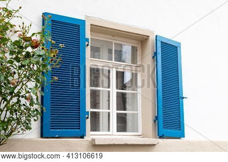 Window With White Wooden Frames, Blue Shutters And A Rose Bush. Image Of Trendy Decor, Comfort, Beau