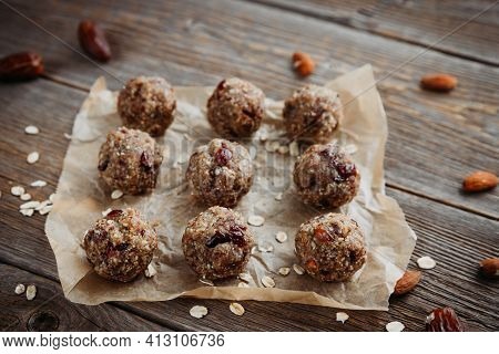 Close-up Of Homemade Dried Fruit, Nuts And Oatmeal Balls. Energy Balls On A Wooden Table And Ingredi