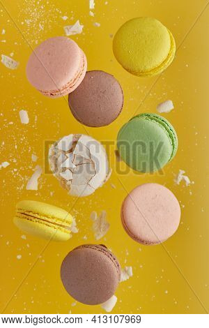 Vertical Photo Of Macaroon. Colorful Cake Macaron With Pastel Tones And White Cracked Macaroon With