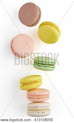 Vertical Photo Of Macaroon. Colorful Cake Macaron With Pastel Tones Fall At The Stack Macaroon On Wh