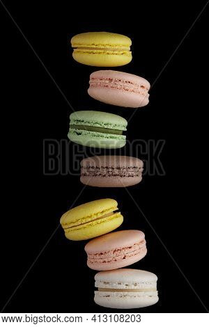 Macaroon. Colorful Cake Macaron With Pastel Tones Fall At The Stack Macaroon On Black Background. To