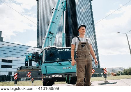 July 30, 2020. Minsk, Belarus.a Driver Next To A Large Modern Car Crane In The City Of Minsk