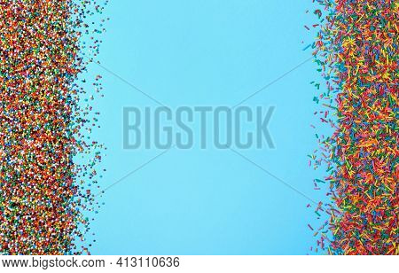 Colorful Sprinkles On Light Blue Background, Flat Lay With Space For Text. Confectionery Decor