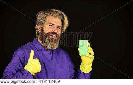 Disinfection Concept. Bearded Cleaner In Blue Uniform. Spring Cleaning. Hipster Clean House. Virus A