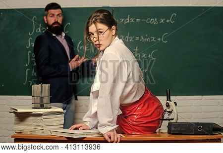 Flirting With Colleague. Everyone Dreaming About Such Teacher. Attractive Teacher In Leather Skirt.