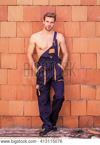 Building Construction. Man Build Own House. Handsome Sexy Laborer. Attractive Worker. Inspecting Bui