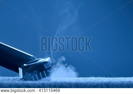Home Cleaning. Steam Carpet Cleaning On Blue Background. Photo With Copy Space.