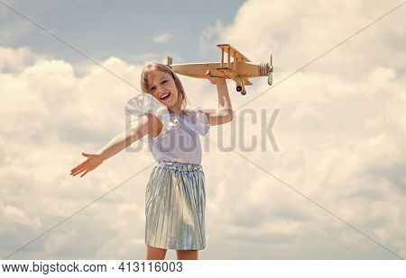 Travel To Summer. Kid Play Wooden Toy Airplane. Study Geography. Dreams About Travel. Story About Su