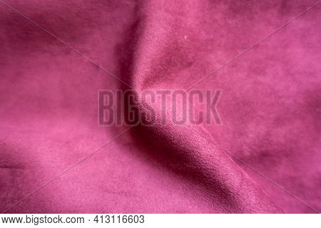 Rumpled Cerise Colored Faux Suede Fabric From Above