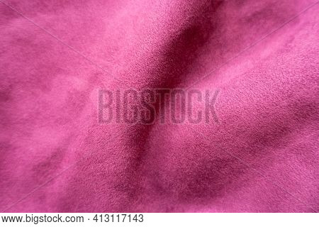 Soft Folds On Cerise Colored Faux Suede Fabric