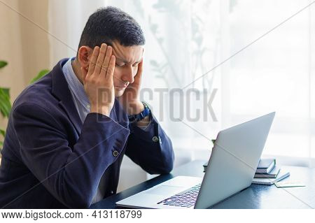 Tired Upset Businessman, Attractive Man In Suit On Workplace For Laptop Feeling Fatigue, Stress, Hea