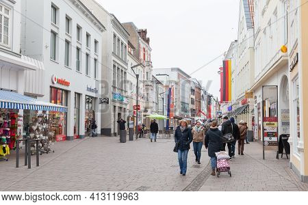 Flensburg, Germany - February 9, 2017: Ordinary People Walk The Grosse Strasse, It Is A Shopping Str