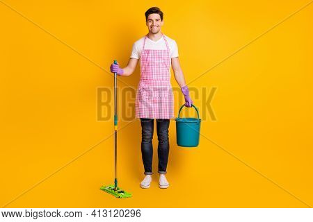 Full Size Photo Of Young Handsome Happy Positive Good Mood Man Hold Mop And Bucket Isolated On Yello
