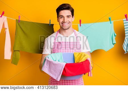 Photo Of Young Happy Handsome Positive Good Mood Smiling Man Hold Basin With Clean Clothes Isolated
