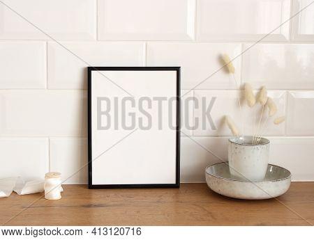 Closeup Of Kitchen Interior. White Brick Wall, Metro Tiles, Wooden Table. Modern Ceramic Vase With D
