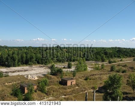 View From Above On The Site With Old Destroyed Buildings, Overgrown Grass And Trees.