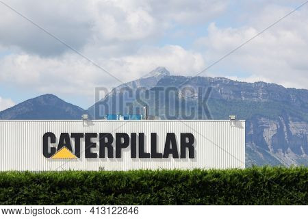 Grenoble, France - June 16, 2019: Caterpillar manufacturing plant. Caterpillar is an American corporation which designs, develops, engineers, manufactures, markets and sells machinery, engines
