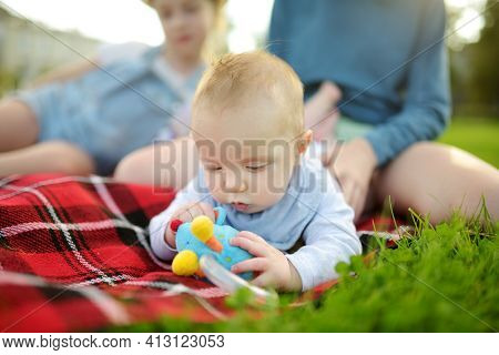 Cute Five Months Old Baby Boy Lying On His Tummy. Baby Playing With A Toy During Tummy Time. Cute Li