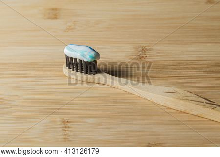 Toothbrush With Toothpaste On The Table. Copy Space And Negative Image Space. Tooth Brush Concept. T
