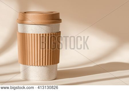 Sustainable Bamboo Eco Friendly Cup With Silicone Holder On Natural Shadow Beige Background. Reusabl