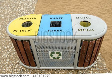 Bins For Separate Waste Collection On Beach. Inscriptions: Paper, Unsorted Waste, Glass, Plastic. Co