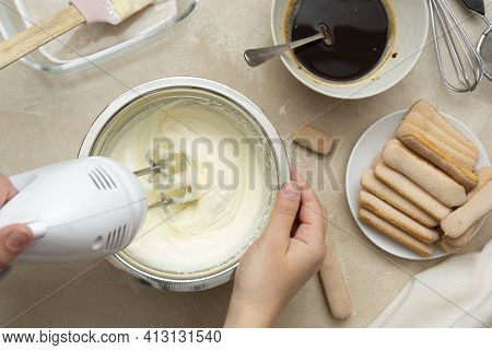 Mixing, Whipping Cream For Cake. Cooking Tiramisu Cake With Sponge Fingers Cookies. Step By Step Rec