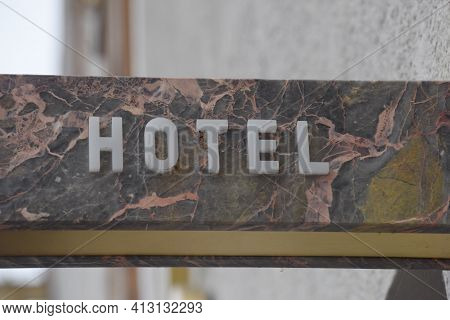A Hotel Sign In Tourism, Overnight Stay And Guest Bed For Tourists