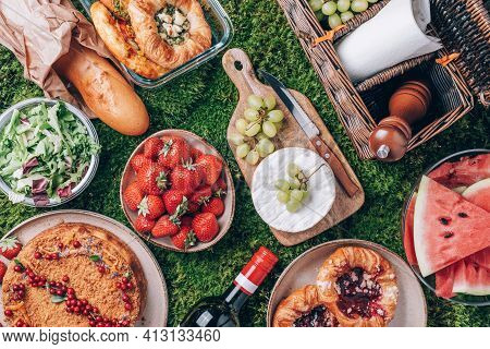 Picnic Straw Basket With Healthy Food, Accessories. Summer Picnic With Cake, Fruits, Cheese, Wine An