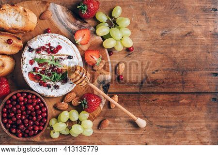 Baked Camembert Cheese With Honey, Rucola, Cranberry, Toasted Bread, Grape, Strawberries, Almond Nut