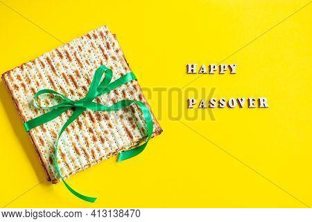 Celebrating The Traditional Jewish Holiday Of Passover. Matzo On Yellow Background. Pesach Matzah.