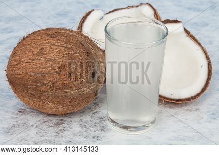 Healthy And Natural Coconut Water; Photo On Neutral Background.