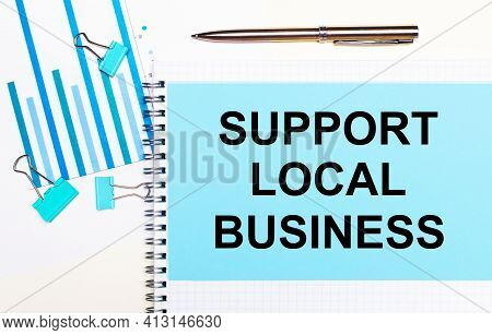 On A Light Background - Light Blue Diagrams, Paper Clips And A Sheet Of Paper With The Text Support