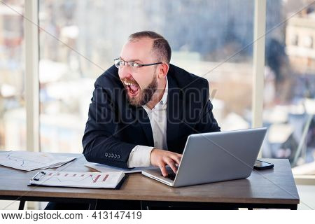 The Corporate Madman Is Sitting At The Computer In The Office And Going Crazy, The Emotional Portrai