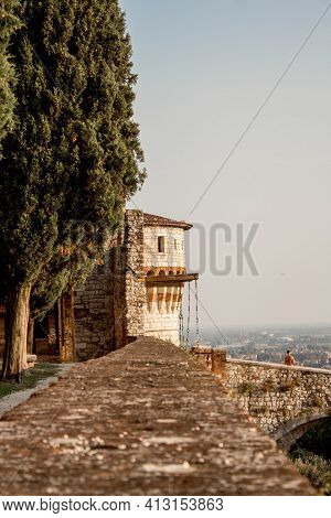Medieval Stone Castle Or Castello Di Brescia With Battlements, A Tower, Drawbridge And Ramparts. Lom