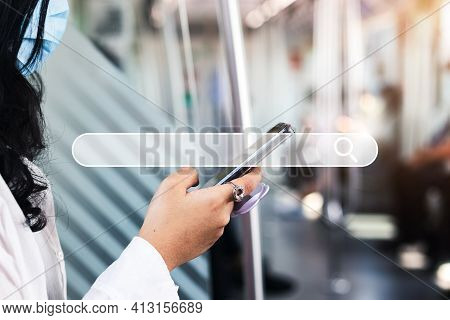 Woman's Hand, Use A Smartphone To Find Things That Interest You. Finding Information About Internet