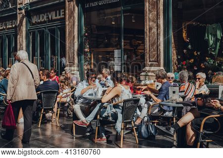 Brussels, Belgium - August 16, 2019: People At The Tables Of Le Pain Quotidien Cafe Inside Royal Gal