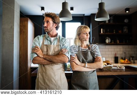 Unhappy Couple Having Argument And Fight In Kitchen That Leads To Divorce